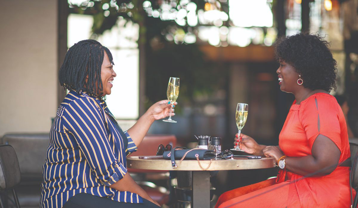 two-female-friends-having-champagne-at-restaurant-the-square